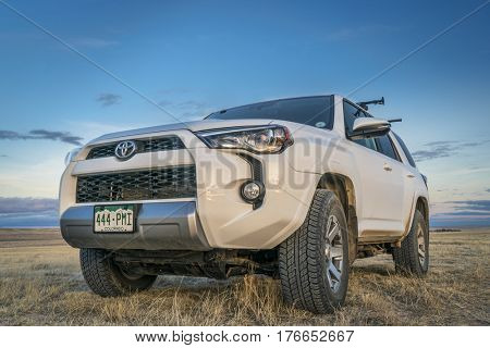 PAWNEE NATIONAL GRASSLAND, CO, USA - MARCH 11, 2017: Toyota 4Runner SUV (2016 Trail edition) on Grassland Road 640 in north eastern Colorado.