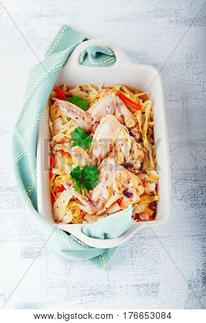 Braised cabbage with chicken on a white surface