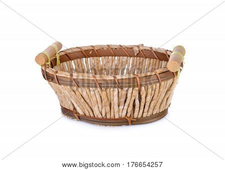 empty corn husks basket on white background