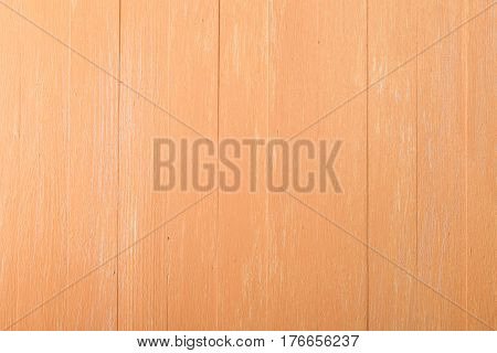 Orange wood background. Painted scraped wooden board. Bright texture or pattern.