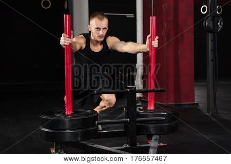 Young Athlete Man Getting Trained On Gym Equipment In Gym