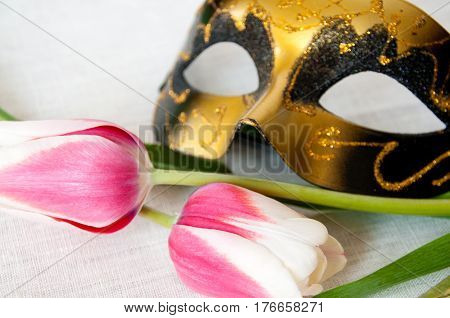 Red And White Tulips Golden Mask On White Linen Fabric