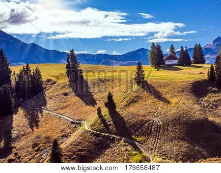 Concept pedestrian and eco-tourism. The natural landscape of the Alps di Siusi. Wonderful quiet mountain valley in autumn. The  Dolomites - World Natural Heritage