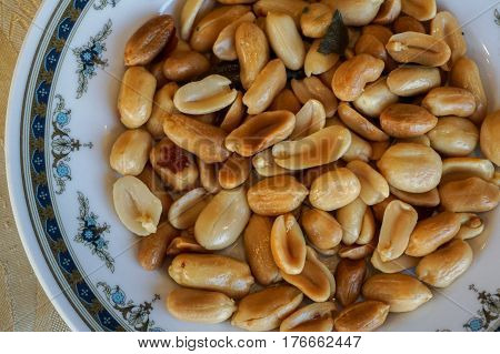 Roasted salted peanuts in bowl,side view.Peanuts are rich in proteins.The amino acids present in them are good for proper growth and development of body