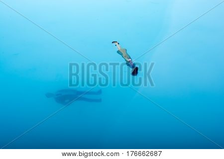 Little floating figurines in the blue water