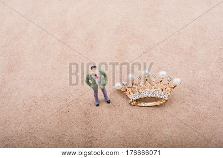 Figurine And Golden Color Crown Model With Fake Pearls