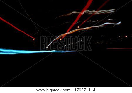 zoom out effect light streaks and traffic trails at night abstract background street scene