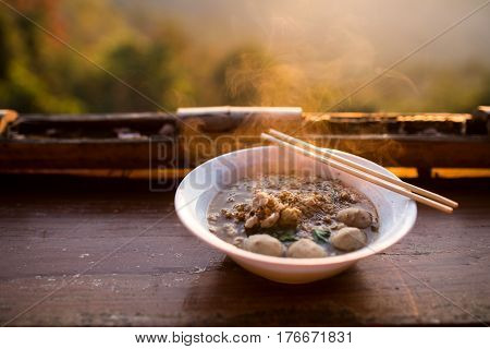 A Noodle With Landscape Of Mountain In The Morning