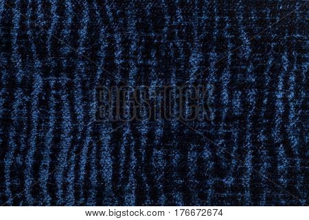 Navy blue and gray background of soft fleecy cloth. Texture of textile closeup.