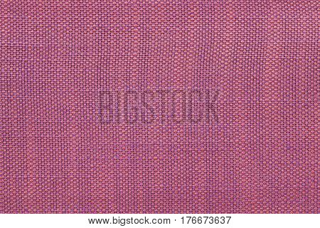 Pink and purple background with checkered pattern closeup. Structure of the fabric with checkerboard pattern macro.