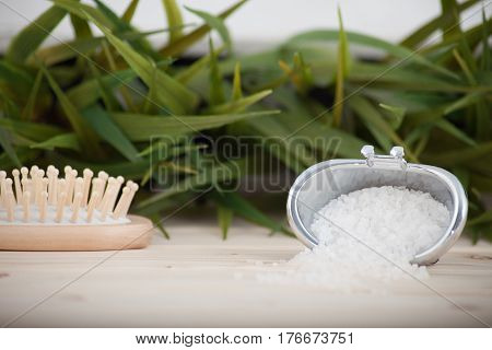 Natural bath salt, organic products poured into a container in the sape of a bath