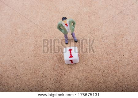 Figurine By The Side Of The Colorful Alphabet Letter Cube I