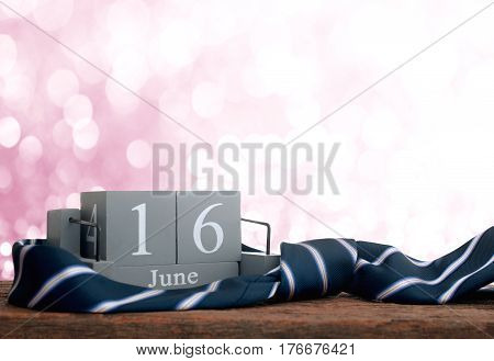 Vintage Wood Calendar For June 16 With Necktie Happy Father's Day Inscription Background Concept.