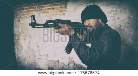 Terrorist In Black Uniform And Mask With Kalashnikov