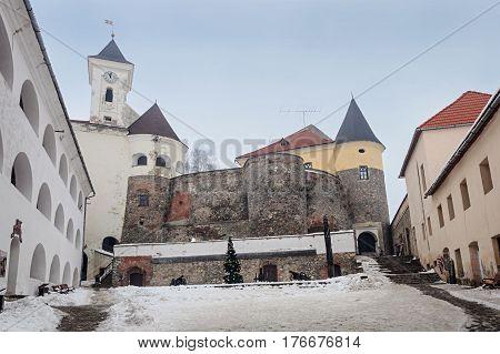 Inner courtyard of ancient castle Palanok in Mukachevo Ukraine. Winter time.