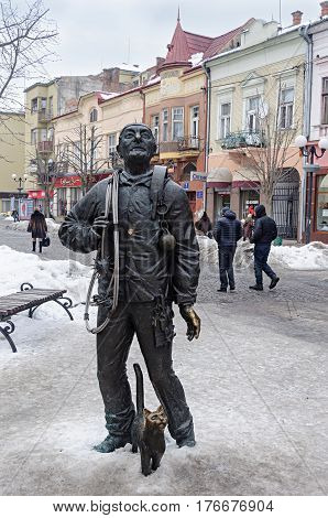Mukachevo Ukraine - January 31 2017: Statue of chimney sweeper with cat