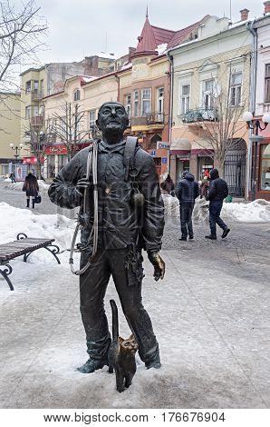 Mukachevo Ukraine - January 31 2017: Statue of chimney sweeper with cat