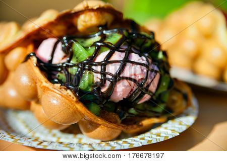 Appetizing Hong Kong waffles with the ice cream stuffing on a table.