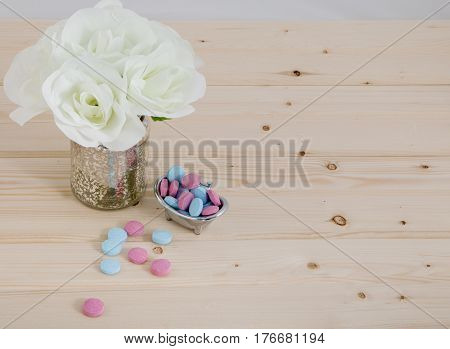 Bath Time  color tablets for kids on wood background with bunch white flowers