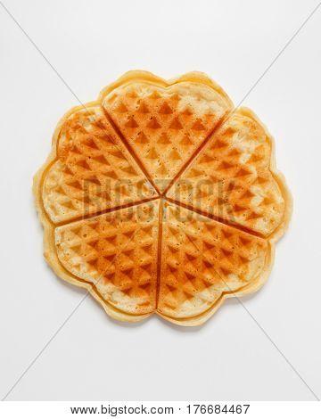 Belgian heart shaped waffle on white background