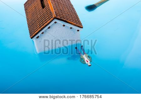 Little Model House  And Figurines In Water