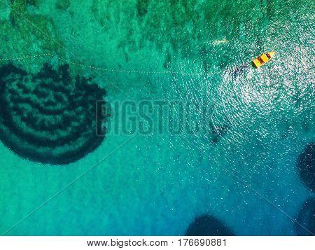 Aerial view of boat at turquoise sea, Island Brac, Croatia.