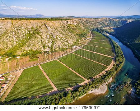Aerial view of hills and plantation next to Neretva river in Bosnia and Herzegovina. Aerial view of famous Bosnian Valley next to Neretva river in Bosnia and Herzegovina.