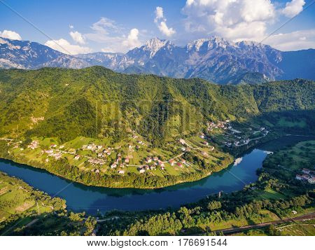 Aerial view of mountain alps and houses next to Neretva river in Bosnia and Herzegovina.