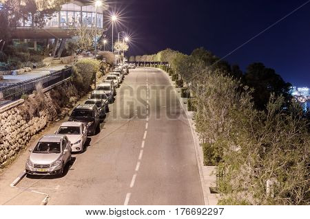Haifa Israel - February 17 2015 : Quiet street and promenade at night in Haifa Israel