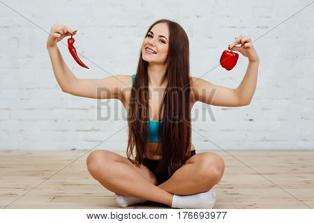 Beautiful Young Girl With Braces Holding Pepper