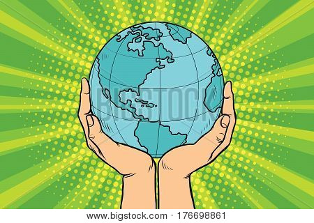 Blue planet Earth in human hands. Pop art retro vector illustration