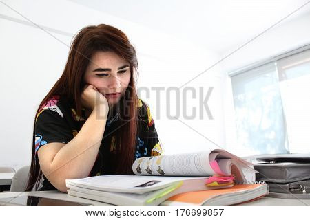 Pretty Young Girl With Long Beautiful Hair Study In University And Reading Book