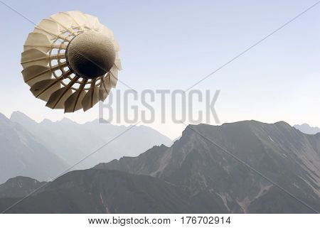 Abstract badminton illustration - Flying shuttlecock over the Alps.