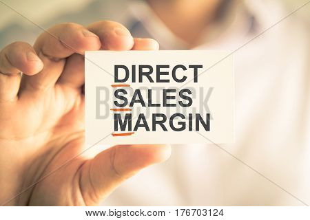 Businessman Holding Card With Dsm Daily Sales Margin Acronym Text