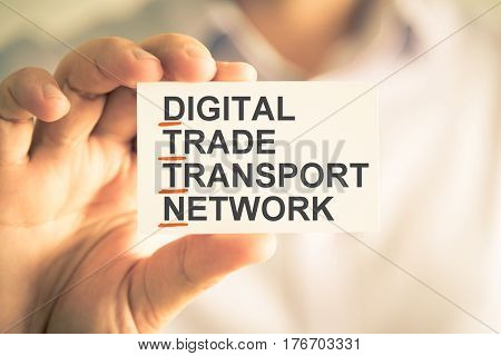 Businessman Holding Card With Dttn Digital Trade Transport Network Acronym Text