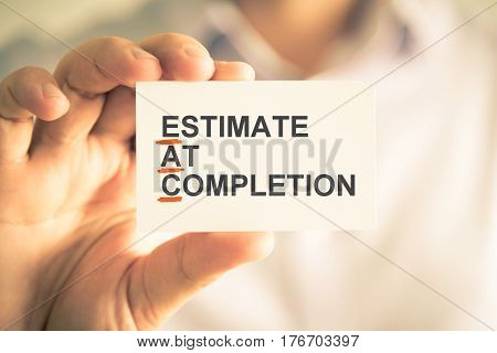 Businessman Holding Card With Eac Estimate At Completion Acronym Text