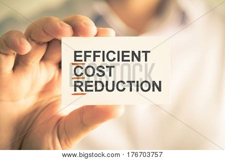 Businessman Holding Card With Ecr Efficient Cost Reduction Acronym Text