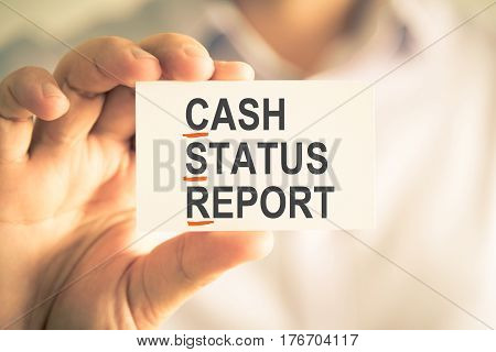 Businessman Holding Card With Csr Cash Status Report Acronym Text