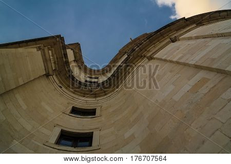 Look up view along the wall National Pantheon at sunset in Lisbon Poetugal