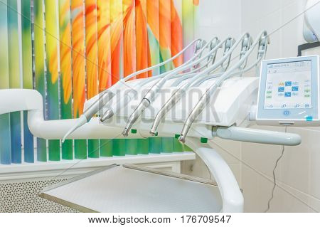 Different dental instruments and tools in a dentists office. Closeup dental tools