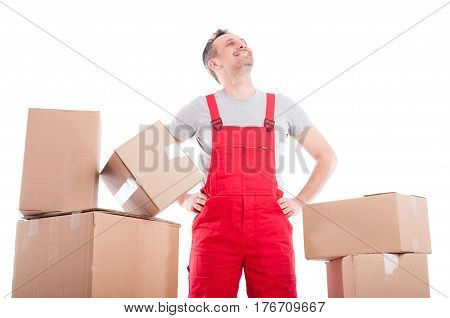Mover Man Standing Looking Up Between Cardboard Boxes