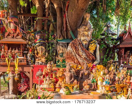 Figurines around a sacred tree in Pattaya Chonburi province of Thailand.