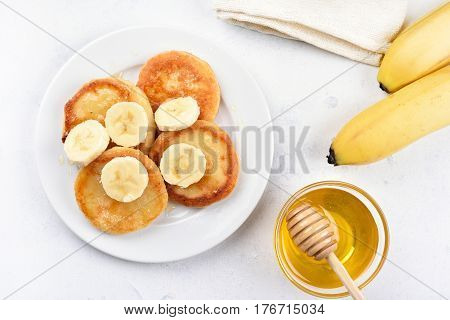 Cottage cheese pancakes with banana slices healthy breakfast top view