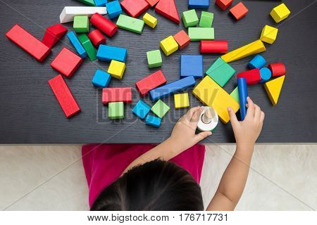 Child's Hand Close Up Playing Building Blocks