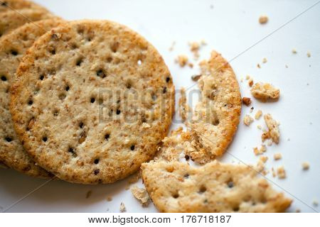 Healthy wholewheat crackers on a white background