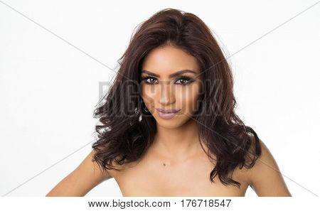 Beautiful woman's face with bare shoulders