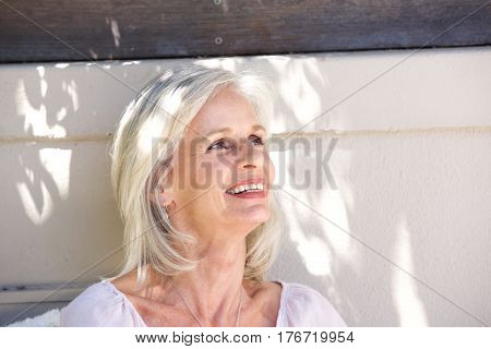 Beautiful Older Woman Smiling Outside Looking Relaxed