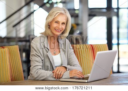 Beautiful Older Woman Working Laptop Computer Inside