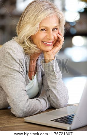 Happy Older Woman With Laptop Computer