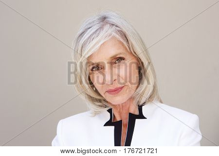 Beautiful Older Woman Staring Standing By Wall